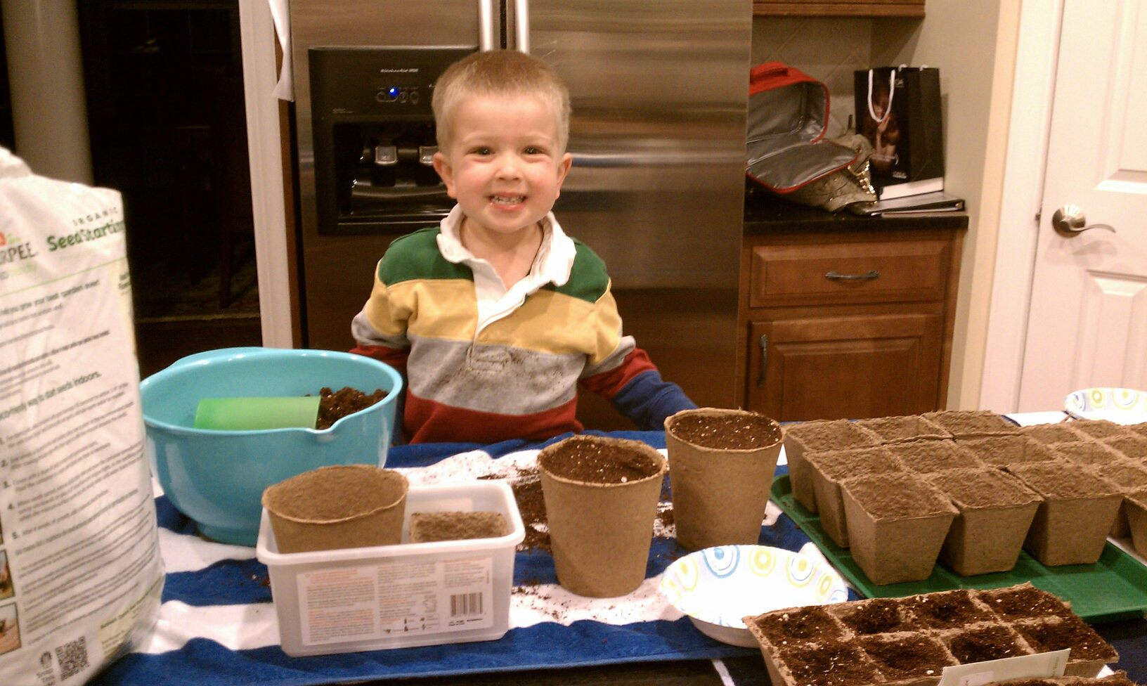 My son getting the seeds ready for the garden